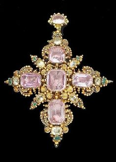 An early 19th century topaz, chrysoprase and emerald cross brooch/pendant, circa 1830. The cross set with oval and cushion-shaped foiled pink topaz, to a gold cannetille surround, with cushion-shaped chrysoprase and emerald detail, to closed-back settings