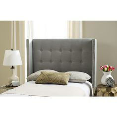 Inspired by the relaxed luxury the defines classic New England style, this linen headboard is a designer favorite. Its clean lines and polished nailhead trim atop classic silver upholstery create an aura of stately elegance in any bedroom.