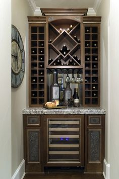 Dark colored cabinet with built in fridge.