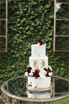Red, white and gold wedding cake.