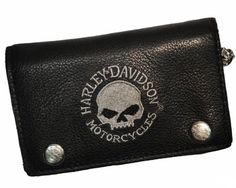 """Skull Embroidered Chain Wallet"" Made in America! This great wallet closes with two strong snaps and has the classic gray Willie G. skull embroidered on the front. Very clean design! It features 1 ID slot, 2 slots, 2 pockets/slots, and 1 cash slot. It also features a zippered pocket on the left inside flap. The chain measures 19"" from the wallet to the lobster claw closure. The chains are removable. The wallet measures 5 ¾"" x 3 ¾"""