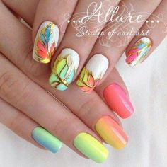 Rainbow Shaded Nails. Rainbow and colors are all associated with the spring and you can get this on your nails to get the amazing feel of spring. The mix of yellow, blue, green, orange and red along with the white color looks extraordinary, just like the rainbow in the spring season. The gold outline is also a plus for this design.