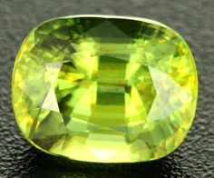 """4.14cts VVS Yellow / Green Sphene (Titanite) (RCG51) This sphene displays stunning brilliance. The gemstone features """"fire"""" phenomena which is a special feature of Sphene. In one direction the gem displays a canary yellow colour, in the other direction the gem jumps to life with flashes of green """"fire"""". This gem is brilliantly cut by a skilled cutter."""