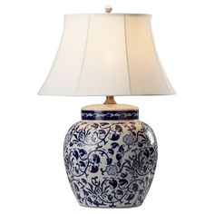 Crafted of ceramic and featuring a chinois-inspired design, this lovely table lamp is an essential addition to any decor. Let it welcome guests on your entryway console, brighten your bedroom vanity, or illuminate your favorite reading nook.
