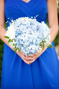 The bridesmaids carried soft bouquets of light blue and white hydrangeas, baby's breath and green ruscus leaves.
