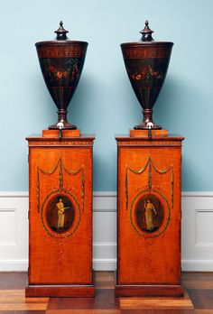 A pair of consoles with urns; iron and painted maple  England, c. 1770