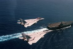 "A pair of VF-143 ""Pukin' Dogs"" Tomcats running CAP over the USS George Washington"
