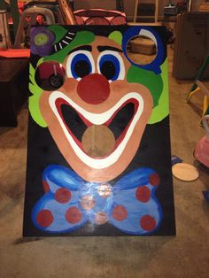 Hand painted clown bean bag toss for Carnival party.