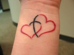 Two hearts joined by a cross. Like this idea.