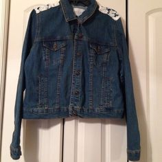 Jean Jacket with Lace panel NWOT super cute Jean jacket that has lace panel on upper back.   Bought but never worn and has been waiting for a new home.  Brand is Delias and is smaller than a true XL but should work for either L or XL. Jackets & Coats Jean Jackets