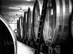 Large wooden tanks impart different flavors into wine than the smaller 60 gallon barrels.