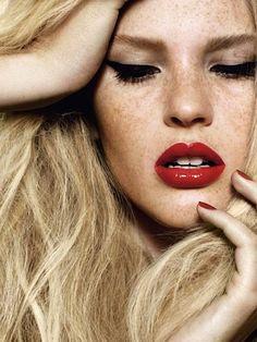 freckles, black liner, red lips, blonde