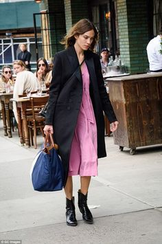 Howdy partner! Alexa Chung looked radiant as she made the sidewalk her catwalk in a pink dress and cowboy boots in New York City on Sunday
