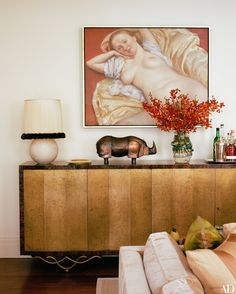 In Marc Jacobs' living room, a John Currin painting hangs above the room's Eugène Printz cabinet | archdigest.com