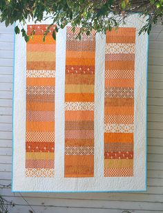 I have to make one of these.  I've seen several lately and I love the horizantal stripes broken up by the vertical white.