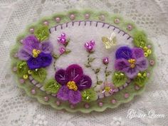 *FELT ART ~ Pansy pin with purple pansies and Swarovski crystal butterfly Felted Wool Crafts, Felt Crafts, Fabric Crafts, Sewing Crafts, Felt Embroidery, Felt Applique, Silk Ribbon Embroidery, Felt Flowers, Fabric Flowers