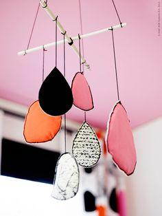 Homemade mobile: I could see making this with some wonderful colorful fabrics like Kaffe, Amy, etc.