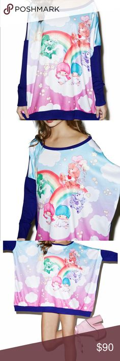 Little twin stars Care Bears Japan la sweatshirt Japan L.A. Little Twin Stars X Care Bears Poncho Sweatshirt ...it's a double rainbow across tha sky, kitten! This adorable oversized long sleeve sweatshirt features sum playful Care Bears and yer fav siblings Kiki & Lala playing in the sky, super soft pastel gradient coloring, contrasting purple sleeves and back, and an ultra cozy wide neck and dropped arm fit so you can lounge like you're in the clouds!  O/s. polyester blend Tops Sweatshirts…