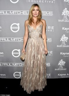 Golden goddess: The actress rocked a shiny nightie-inspired number at the event held at 3L...