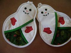 These handmade snowman potholders are a prefect gift for Christmas or any snowman enthusiast! The insulated batting and front pocket is great to protect your hands from heat. The material that is used in the inside of the pocket is also used on the back of the potholders. Of course these snowman potholders are made from all new materials and are machine washable