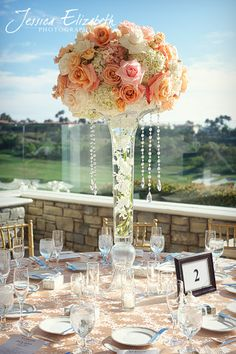 This is exactly what I want for centerpieces!!! Just different color roses and an led light under the vase! Wow