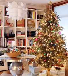 Vintage Christmas trees never go out of style! More Christams tree ideas: http://www.bhg.com/christmas/trees/christmas-tree-pictures/?socsrc=bhgpin112713vintagechristmastree&page=13