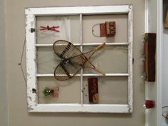 Old window recycled with ornaments for Christmas. You can change the hangings to fit the season
