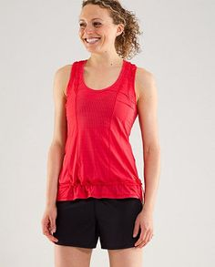 Lululemon Run: Mind Over Matter SL Tech top : Great exercise top with super sweat-absorbing ability. Love the loose fit, ruffles, color and the chord at the bottom which allows you to adjust fit (shirt doesn't flip over in headstand!). Also comes with discreet secret pocket for card, keys.