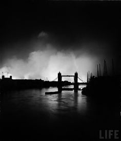 """Tower Bridge silhouetted against the fires burning on London's docks, ignited during German air raid attack on the city"", by William Vandivert, September 1940 [1095 × 1280]"