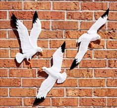 """Seagull 3/set Sea Gull Soaring Birds Wall Plaques. Three individual Large Seagulls in various forms of flight. You get all three.  Add a coastal touch to your home, or garden, with these realistic life sized sea birds.   Made in the U.S.A. from rust free cast aluminum and finished with weather resistance paint for decades of enjoyment. Each seagull statue has a hanger on the back for attaching to a wall. Average size: 20"""" x 9"""".   Gulls In Flight weigh approx. 3 lbs. total.  Actual…"""