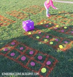 Making 10! An engaging way to make 10 using giant ten frames, frisbee counters, and inflatable dice. This was part of our 100th Day of School--Secret Agent Mission!