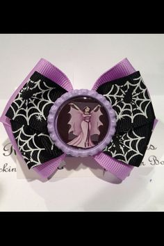 Lily Munster hair bow hair clip  by RockinRebelBowz on Etsy, $4.00