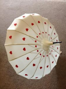 Ivory Edwardian Style Umbrella with Cascade of Red Heart Design | Love Umbrellas