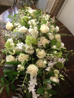 white and green spring coffin spray by Matthew Spriggs, Spriggs Florist