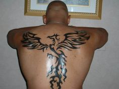 The ancient lore of the Phoenix originated from Greek and communicates to a bird that cannot die. Here is the best collection of Phoenix Tattoos for you. Rising Phoenix Tattoo, Phoenix Tattoo For Men, Tribal Phoenix Tattoo, Phoenix Bird Tattoos, Phoenix Tattoo Design, Tribal Bird Tattoos, Bird Tattoo Men, Bird Tattoo Back, Tattoo Son