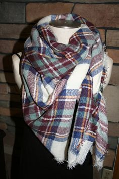 You are looking at the popular Plaid blanket scarf, 2014 favorite. Approx 56 x 56, nice soft and warm scarf! Maroon Blue plaid print! This