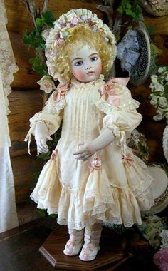 "*BEBES ~ by: Sayuri, Bru Jne 13"".  REPRODUCTION DOLL: dress is made entirely of antique material from a very fragile antique silk dress.  The angelie mohair wig is created by Wendy Feidt.  She has an antiqued kid body w/ bisque shoulder plate + bisque hand."