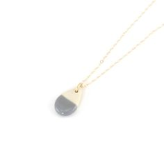 Tiny dipped teardrop necklace in dark grey. Also in nude, navy, gold, and gold line.