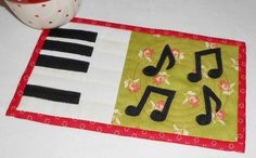 Looking for quilting project inspiration? Check out Musical Notes Mug Rug by member The Patchsmith.