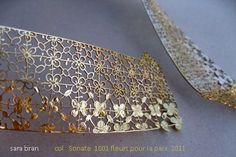 Sara Bran jewelry, lace pattern cut into the gold