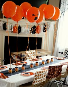 Decoration idea- jars filled with festive candy holding balloons.