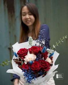 A sensual concoction of red and blue colour theme bouquet consisting of red rose stalks) with blush spray-colour carnation stalks). Red Rose Bouquet, Flower Bouquets, Flowers, Public Holidays, Flower Delivery, Carnations, Color Themes, Special Day, Red Roses