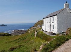 Whitewashed Cornish Cottage overlooking the coast :)