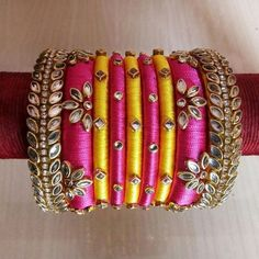 Check out these silk thread bangles design like multicolored bangles, handmade bangles, kundan bangles, etc and find the most stylish silk thread bangles for bride. Silk Thread Bangles Design, Silk Bangles, Silk Thread Earrings, Bridal Bangles, Thread Jewellery, Kundan Bangles, Fashion Jewellery, Fashion Bracelets, Bangles Making