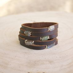 Hand wrapped Labradorite in sterling wire on hand cut supple leather. Pure luxury on your wrist. Blue Pearl, Signature Logo, Leather Accessories, Labradorite, Cuff Bracelets, Brown Leather, Handmade Jewelry, Pure Products, Gemstones