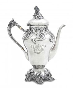 An American Art Nouveau Sterling Silver Coffee Pot.