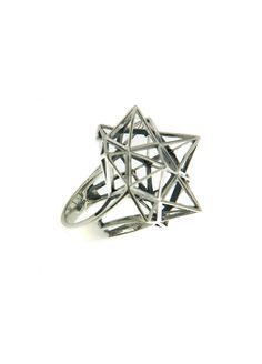 This geometric statement ring rendered in silver features intricate pyramid shapes.   Please note: This item is final sale.