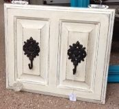 Old cabinet doors repurposed to laundry room or entry way hangers. #diy