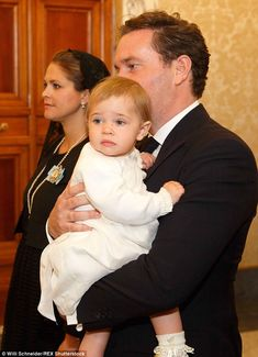 Princess Leonore was carried into the audience with Pope Francis at the Vatican today by her father, Christopher O'Neill, next to her 7-month pregnant mother, Princess Madeleine of Sweden. 27 April 2015.