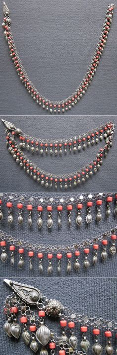 A chest or headgear ornament, for women.  Kurdish, from northern Iraq, ca. 1900-1925.  Silver alloy and coral.  With one pear-shaped plate with a hook.   (Inv.n° müç054 - Kavak Costume Collection, Antwerpen/Belgium).